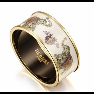 HERMES Gold Elephant bracelet with white enamel!!